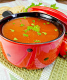 Tomato soup in red ware on napkin Royalty Free Stock Photo