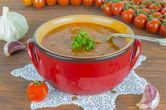 Tomato soup. Roasted tomato soup with beans, garlic and sweet pepper Royalty Free Stock Photo