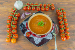 Tomato soup. Roasted tomato soup with beans, garlic and sweet pepper Stock Photos