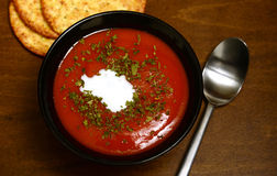 Tomato soup on a rustic wooden background Royalty Free Stock Photography
