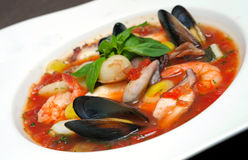 Tomato soup with seafood and fish Stock Photo