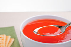Tomato soup on spoon Stock Photo