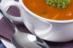 Tomato soup and spoon. A bowl of tomato soup and a spoon on the side royalty free stock photos