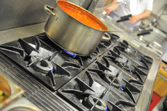Tomato soup on stove. Tomato soup in a restaurant kitchen Royalty Free Stock Photo