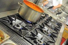 Tomato soup on stove  Royalty Free Stock Photo