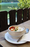 Tomato soup and summer terrace Royalty Free Stock Photo
