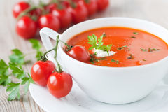 Tomato soup. Tasty tomato soup in a bowl with fresh parsley Stock Photography