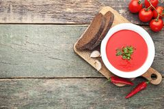 Tomato soup. With parsley on wooden table stock photo
