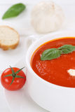 Tomato soup with tomatoes and baguette in bowl Stock Photography