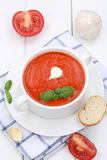 Tomato soup with tomatoes and baguette in cup Royalty Free Stock Photos