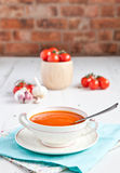 Tomato soup with tomatoes on the white table Royalty Free Stock Photos