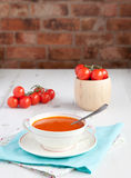 Tomato soup with tomatoes on the white table Stock Photography
