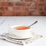 Tomato soup with tomatoes on the white table Stock Photo