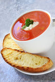 Tomato Soup with Turkish Bread. Tomato soup with toasted Turkish bread, in a white soup bowl Stock Photo