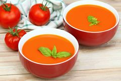 Tomato soup in two red bowls Stock Photo