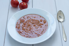 Tomato soup. A warming tomato soup with zucchini in the cold season Royalty Free Stock Photos