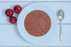 Tomato soup. A warming tomato soup with zucchini in the cold season Royalty Free Stock Image