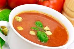 Tomato soup in white bowl Stock Photos