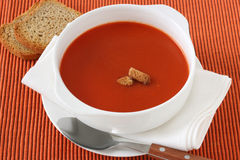 Tomato soup in white bowl Royalty Free Stock Images