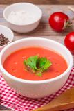 Tomato soup in a white bowl . Traditional red cold gazpacho soup with tomatoes. Spanish cusine.  royalty free stock photos