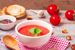 Tomato soup in a white bowl . Traditional red cold gazpacho soup with tomatoes. Spanish cusine.  stock photos