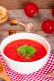 Tomato soup in a white bowl . Traditional red cold gazpacho soup with tomatoes. Spanish cusine.  stock photo
