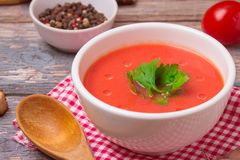 Tomato soup in a white bowl . Traditional red cold gazpacho soup with tomatoes. Spanish cusine.  royalty free stock photography