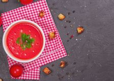 Tomato soup in a white bowl . View frome above. Copy space. Traditional red cold gazpacho soup with tomatoes. Spanish cusine. Tomato soup in a white bowl. View royalty free stock photo