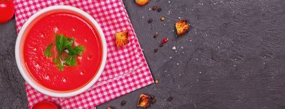 Tomato soup in a white bowl . View frome above. Copy space. Traditional red cold gazpacho soup with tomatoes. Spanish cusine. Long. Format. Banner stock photography