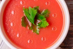Tomato soup in a white bowl . View frome above. Traditional red cold gazpacho soup with tomatoes. Spanish cusine. Tomato soup in a white bowl. View frome above stock photo