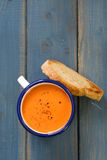 Tomato soup in white mug Royalty Free Stock Images