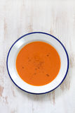 Tomato soup in white plate Stock Images