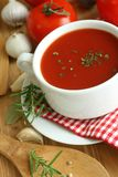 Tomato soup on wooden board Stock Images