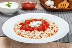 Tomato soup with yogurt and pasta stock photos