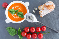 Tomato soupe on grey background Royalty Free Stock Image