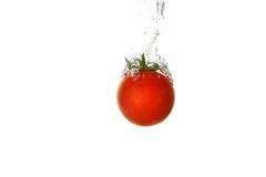 Tomato splash. A tomato splashing into water Royalty Free Stock Photography