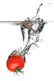 Tomato splashing in water stock photography