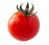 Tomato on spoon Stock Images