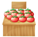 A tomato stand with an empty wooden signboard Royalty Free Stock Photos