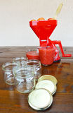 Tomato strainer and empty jars Stock Photos