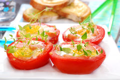 Tomato stuffed with quail egg Stock Photo