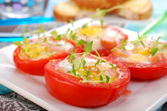 Tomato stuffed with quail egg Royalty Free Stock Photos