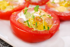 Tomato stuffed with quail egg Stock Images