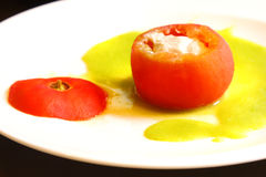 Tomato stuffed with tuna. A plate of stuffed tomato with tuna fish Stock Image