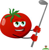 Tomato swinging his golf club Stock Photo