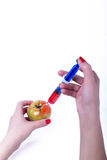 Tomato with syringe Stock Images
