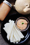 Tomato Tahini with Jicama Fries on top Royalty Free Stock Photos