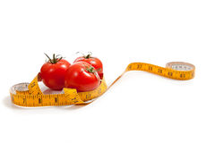 Tomato with a tape measure Stock Photo