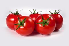 Tomato. On a white background Royalty Free Stock Photography