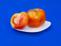 Tomato. Es on the background to create an ideal portfolio Stock Image